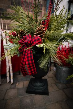 """Loving this buffalo plaid addition to winter planters from container designer June Spanier of Minnesota! Photo credit: Dane Nelsen Featured: 23"""" Crescendo Urn from the recycled rubber planter collection by TierraVerde #winterplanters #holidayplanters #buffaloplaid #winterberry #pineboughs #cedar #recycledrubber #ecofriendlyproducts Winter Planter, Rubber Material, Recycled Rubber, Buffalo Plaid, Urn, Timeless Design, Photo Credit, Minnesota, Christmas Wreaths"""
