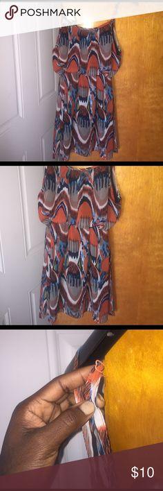 Orange and blue print dress Flowy print orange and blue dress . Adjustable straps.large. 100 %polyester . Dresses