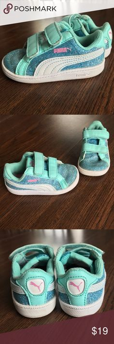 Puma Smash Glitz Glam glitter toddler sneakers Pair of toddler Puma sneakers in size 5. These sneakers are adorable and pictures don't do them justice!! Aqua with all over glitter. In EUC as seen in photos.   I have been the only owner of this item. I am not a consigner. Smoke free home. Please check out my other listings to bundle (and receive an automatic 10%discount!!), and save on shipping. Thank you for looking!! Puma Shoes Sneakers