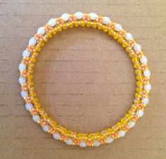 """""""Festival of Lights"""" Daffodil Bracelet with Superduos, 11 & 15 Seed beads and 4mm Fire Polish beads.  Pattern from Jill Wiseman found at:  http://shop.jillwisemandesigns.com/free-project-festival-of-lights-bangle/"""