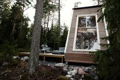 """Built overlooking a lake in Finland, thisMicro Cabin, nicknamed """"Nido,"""" was designed and built by Robin Falck to enjoy once out of the military. It took a while to design and Falck consulted with a couple of architects to get everything right, but the results are phenomenal."""
