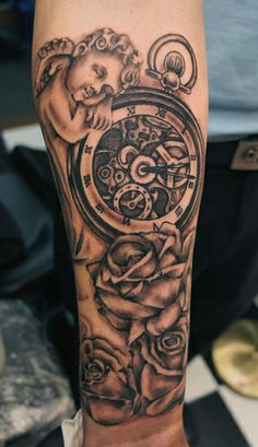 cherub and time piece tattoo