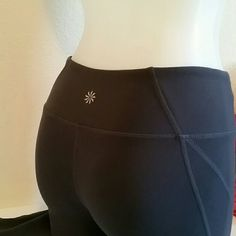 """ATHLETA XXS LEGGINGS In pre -loved conditions.. Gray with purple at the bottom of legs. Inseam about 31"""". Very skinny but stretchy. Color at the bottom is hard to describe ( between purple and blue). Athleta Pants Leggings"""