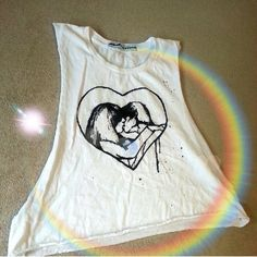 Neurotica white cropped tank Uneven sides, paint spattered. Customized and made this way. Kissing couple front and plain back. Doesn't have a size but would fit small best. Could fit am xs too. Open sides all the way down. You could Wear over a bikini. Please ask any and all questions before buying! xx neurotica Tops Tank Tops