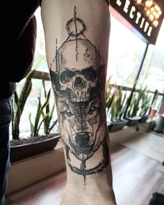 sketch black wolf and skull forearm tattoo idea