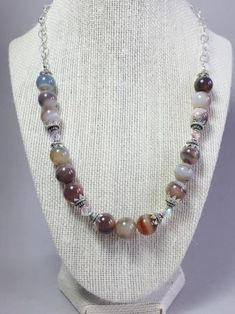 Unique high-quality brown agate sterling silver necklace, made with this beautiful 10mm stripe brown agate, sterling silver caps, sterling silver beads and in between a shiny 6mm white Swarovski that