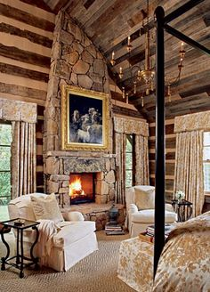 If I live in a log cabin, the stone fireplace is a must. I also the love the high ceilings and the canopy bed.