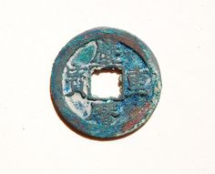 214a. Obverse side of a Qing Li Tong Bao (慶曆通寶) 3 cash coin cast from AD 1041–1048 during the 'Qingli' reign title of Emperor Renzong (仁宗) (1022–1063 AD), of the Northern Song (北宋) Dynasty (960- 1127 AD). The obverse side features 'orthodox' script while the reverse side is plain. 30mm in size; 7+ grams in weight. S-504.