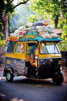 This is how the mass of people get around in India. I have seen one of these with so many people hanging off that you could barely see the body of the auto-taxi.