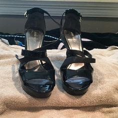 Black Strappy Platforms Nine West Strappy platforms, slight wear on the bottom other than that perfect condition. Just never wear them. Make me an offer! Very flexible! Nine West Shoes Heels