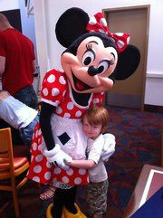 Henry meets Minnie Mouse at Chef Mickey's Character Breakfast at Walt Disney World.