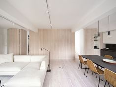 Interior Renovation of Marylebone Apartment by Proctor & Shaw The wood screen wall creates a simple living environment London Apartment Interior, Home Interior, Interior Design, Living Area, Living Spaces, Living Rooms, A As Architecture, Timber Walls, Minimalist Apartment