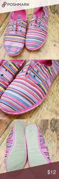 Pink Ikat Striped Slip on Sneakers Shoes - New These slip on tennies are super cute. Made from Ikat fabric in shades of purple, pink, and yellow. They're a great casual shoe that is perfect for summer and into fall.   Brand new, never worn. Unleashed by Rocketdog,  size 9. Rocket Dog Shoes Sneakers