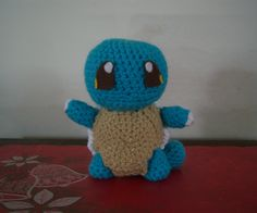 This cute Squirtle was very fun to make. This is the first time I tried my hand at making a pattern. I think it turned out great. I will include the pattern here. Squirtle Pattern –Approx. 6 ½ inches tall Material Needed- G/6 hook Turqua Yarn Carrot Yarn White Yarn Tan Yarn Felt Head- Using Turqua RND 1- CH 2, 6 SC in 2nd CH from hook RND 2- 2 SC in each SC (12) RND 3- 2 SC in next SC, SC in next SC (18) RND 4- 2 SC in next SC, SC in next 2 SC (24) RND 5- 2 SC in nex...