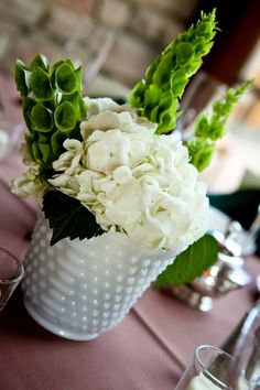 white & green flowers in milk glass vases... perfect seaside vintage, with a touch of green for St Patty's day!