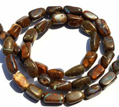 Super Rare Natural Gem Boulder Australian Opal Smooth Nugget Beads Necklace 18 Inches. Finished necklace with silver locks. Product detail. Excellent fire and quality. 5 to 7MM Broad and 7 to 11MM Long Nuggets.