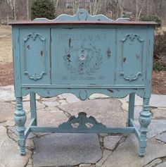 A gorgeous little petite sideboard painted scrumptious teal and stenciled with a time~worn stencil.