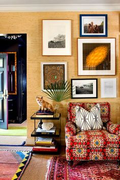 Grasscloth Living Room With Upholstered Chair loving that wild patterned chair and the gallery wall against the grasscloth wallpaper