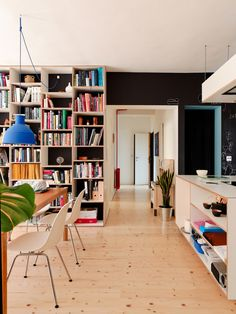 unfold pendant by muuto, black wall + custom made plywood kitchen island + bookshelf | Dwell