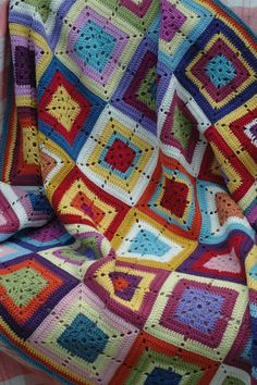 A pile of afghan inspiration. Reminds me of my Mom...best crocheter/knitter ever!