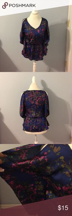 Express Cold Shoulder Drawstring Waist Top Silky material in this blue floral cold shoulder top. Sleeves are batwing style and the top blouses over a drawstring waisted lower. 100% polyester. Express Tops