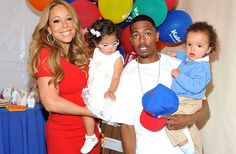 Mariah Carey and Nick Cannon pose for pictures with their twins Monroe Cannon and Moroccan Scott Cannon during 'Family Day' at Santa Monica Pier on October 6, 2012 in Santa Monica, California. | Music's Hottest Moms