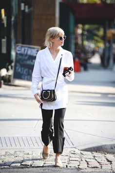 When the robe coat meets the white button-up, you get a little slice of magic like this. #refinery29 http://www.refinery29.com/2016/09/120553/nyfw-spring-2017-best-street-style-outfits#slide-15
