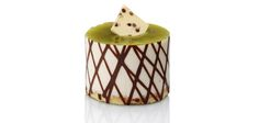 Key lime mousse, vanilla sponge with chocolate chips, chocolate weave texture, white and dark chocolate diamond.