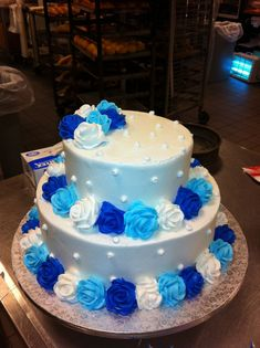 Birthday Cakes - Butter cream wedding cake w/ Light blue , royal blue and white roses