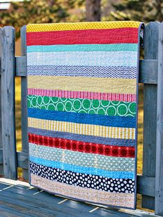 Simple stripes quilted with long, wavy lines.  Looks easy.