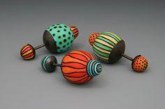 "Jillian Palone, ""Companions"" 2009, hand sculptures: wood, copper, colored pencils, 3 x 1 ½ x 1 ½ x 1 ½."
