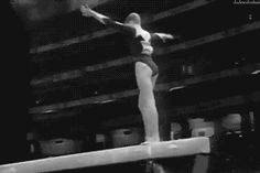 (gif of Svetlana Khorkina's Gainer double twist beam dismount)