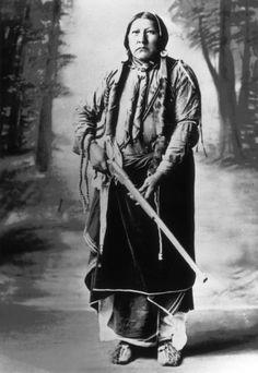 Standing studio portrait of Ti-su-yo, son of Chief Mow-way? Native American Comanche - 1890/1910
