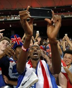 World Athletics Championships 2015: day eight – in pictures   Sport   Farah celebrates with some selfies with the fans