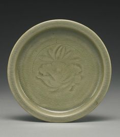 A molded 'Yaozhou' 'Lotus' dish, Northern Song-Jin Dynasty
