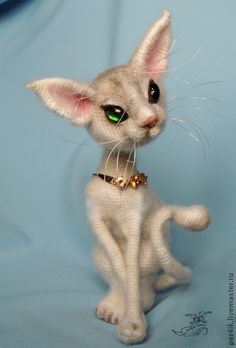 I don't think this is needle felted ~ looks knitted, but it is a cute model for a needle felted cat