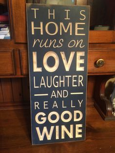 """Custom Carved Wooden Sign - """"This Home Runs On Love Laughter And Really Good Wine"""" by HayleesCloset on Etsy"""
