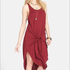 """Free People Back in Town Jersey Dress L- BURGUNDY BRAND NEW WITH TAGS ATTACHED! Authentic Free People Back in Town Jersey Dress, Ladies Size Large- COLOR: BURGUNDY-  An easy pick for traveling or just strolling around town, this super soft jersey dress has flattering sarong-style draping that hugs your hips. Featuring - Scoop neck- Sleeveless- Front tie detail- Hi-lo hem- Approx. 41 1/2"""" shortest length, 44 /12"""" longest length. Retails $98.00 Free People Dresses High Low"""