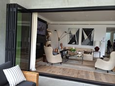 The wide opening to the back patio and the use of natural wood floors really brings the outdoors into this space http://www.greenmtwood.com/pin.html