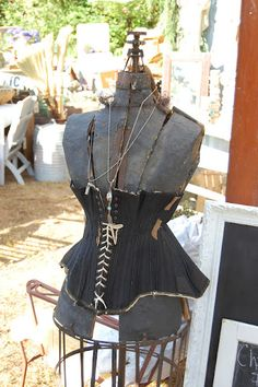Maison Douce...love this vintage corset on an old dress form!