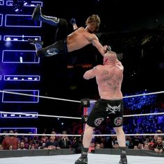 The WWE Champion soars through the air to level Lesnar with laser precision.