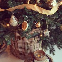 ''I managed to squeeze this #Tree into a chunky wicker basket. It looks so #Rustic and much prettier than a bare stand. The lanterns with faux candles are scattered all around my house makes it so magical at night'' @sophiepatersoninteriors  #SophiePatersonInteriors #ChristmasDecorations #Christmas #Interior #ChristmasTree by sheerluxe