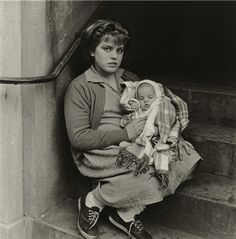 Photo by Diane Arbus Girl on a stoop with baby, N. Diane Arbus, Amazing Photography, Street Photography, Portrait Photography, Mae West, Moma, Schnauzer, Berenice Abbott, San Francisco Museums
