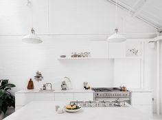 An all-white kitchen in in London is remodeled with budget appliances, Ikea cabinets, and DIY lighting. Here is a list of resources to get the same look. Farrow Ball, Ikea Varde, Bright Kitchens, Ikea Kitchens, Armoire Ikea, House Tweaking, All White Kitchen, Style Deco, Ikea Cabinets