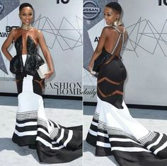 The BET Awards red carpet was stunning this year, but one woman stole the show in a black and white dress with symmetrical details. Nandi Mngoma is the rising South African singer whose red carpet … African Inspired Fashion, Latest African Fashion Dresses, African Print Dresses, African Dress, African Prints, Xhosa Attire, African Attire, African Wear, African Style