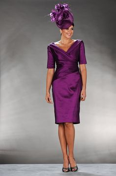 Mother Of The Bride / Groom Outfit: Purple dress with 3/4 sleeves and a v-neck at the front and back