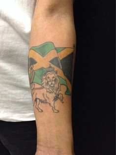 Jamaican Flag Tattoo by shop artist Izzy. Click on the image for more information on how to become a tattoo artist.