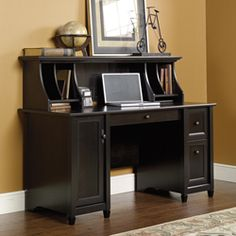 Complete your home office with this elegant computer desk with Estate Black laminate finish that will surely impress.
