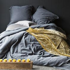 Bella Notte Linens: Madera Duvet Cover in Charcoal*, Madera Euro Shams in Charcoal*, Madera Sheets in Charcoal*, Madera Boudoir in Sable*, Cottonwood Blanket (discontinued) in Sable, Silk Velvet Quilted Blanket in Ginger