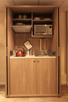 What is a kitchenette? How to make the best of this compact kitchen design? Micro Kitchen, Hidden Kitchen, Compact Kitchen, Small Space Kitchen, Kitchen Units, Small Spaces, Kitchen Cabinets, Small Sink, Gray Cabinets